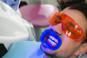 man receiving in-office teeth whitening