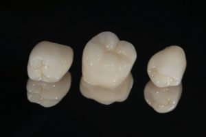 dental crowns on a black background