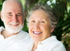 Older couple smiling together.