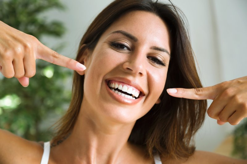 Woman after teeth whitening in Hutchinson