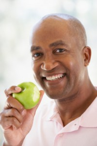 ThinkstockPhotos-Eating Apple Implants