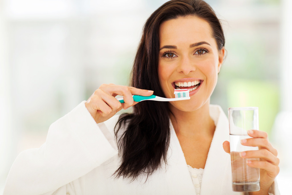 Woman brushes her teeth thanks to a dentist in Hutchinson.