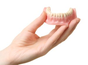 Replace your missing teeth with dentures in Hutchinson.