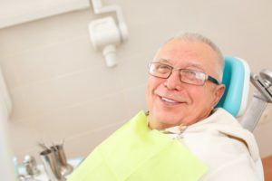 older man sitting in dental chair
